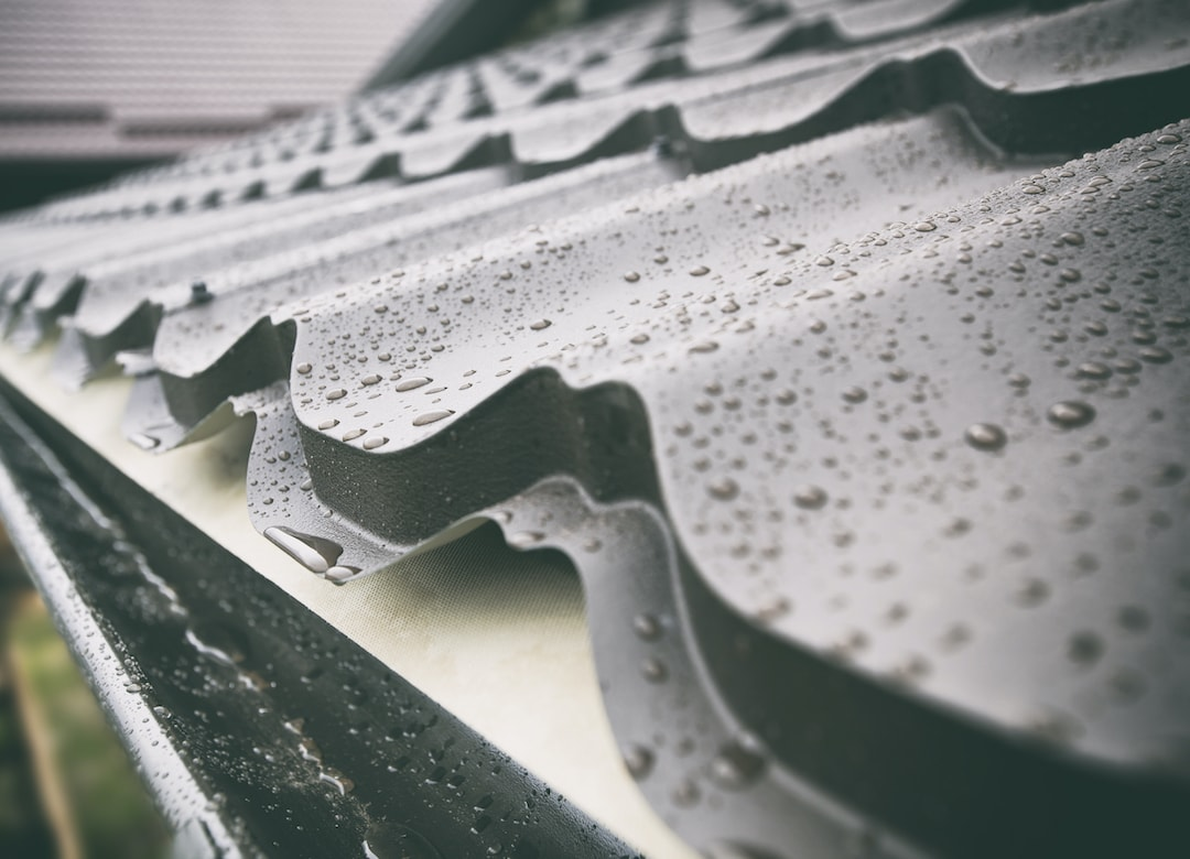 Closeup of wet metal roofing on residential home.